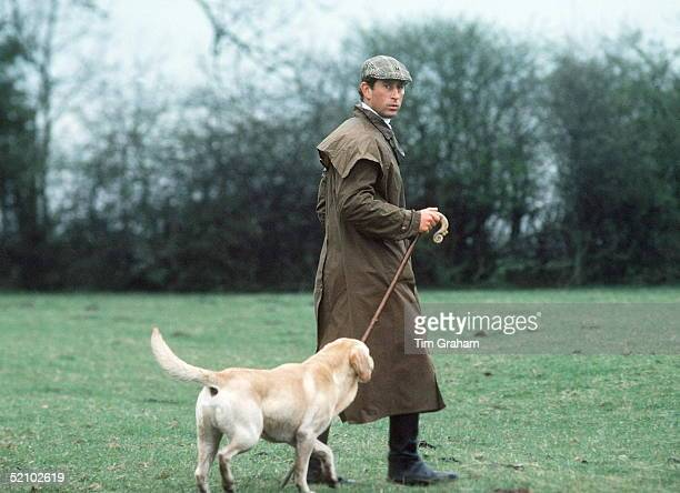 Prince Charles At The Fernie Hunt Cross Country Team Event Wearing Barbour Style/dryasabone Style Raincoat Flat Cap And Walking Stick And With His...