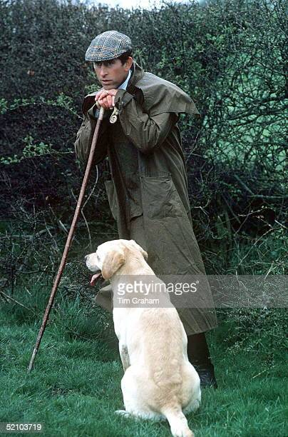 Prince Charles At The Fernie Hunt Cross Country Team Event Wearing Barbour Style /dryasabone Style Raincoat Flat Cap And Walking Stick With His Pet...