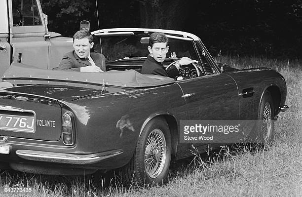 Prince Charles at Windsor for a polo match UK 13th June 1971 He is driving his blue Aston Martin Volante DB6based MKII given to him by his mother the...