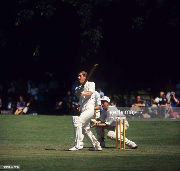 Prince Charles batting when playing for Lord Brabourne's XI against Grand Prix drivers at Mersham near Ashford Kent Wicket Keeper is Robin Widdows