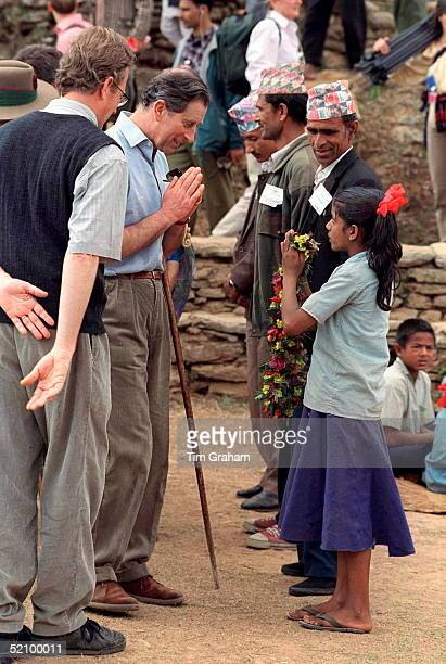 Prince Charles Being Presented With A Floral Garland By A Young Girl On His Trek To The Village Of Bause In The Foothills Of The Himalayas Nepal The...