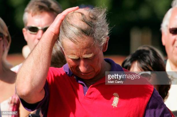 Prince Charles brushes back his hair at the presentation following the Highgrove Polo Team match against Laird polo team in the St James Place...
