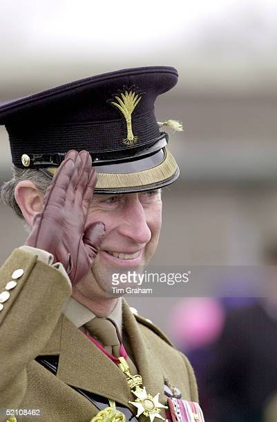 Prince Charles Colonel Of The Welsh Guards Saluting As He Presents Members Of The Battalion With Leeks On St David's Day In Aldershot Hampshire