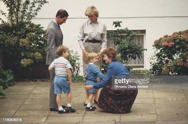 Prince Charles Diana Princess of Wales and Prince William attend Prince Harry's first day at Mrs Mynors' nursery school in London September 1987...