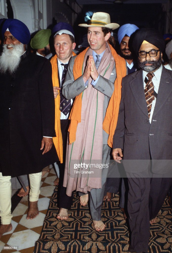 Prince Charles diplomatically walks bare foot with hands in a namaste during a visit to the Golden Temple in Amritsar India