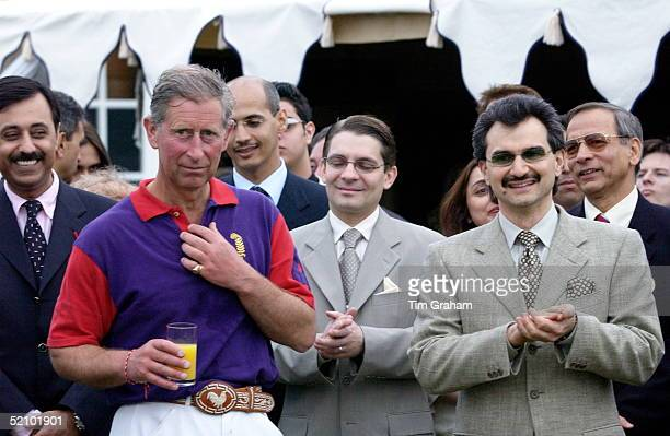 Prince Charles Drinking A Glass Of Orange Juice With Hrh Prince Al Waleed Bin Talal Bin Abdul Aziz Al Saud Of The Saudi Arabian Royal Family At...