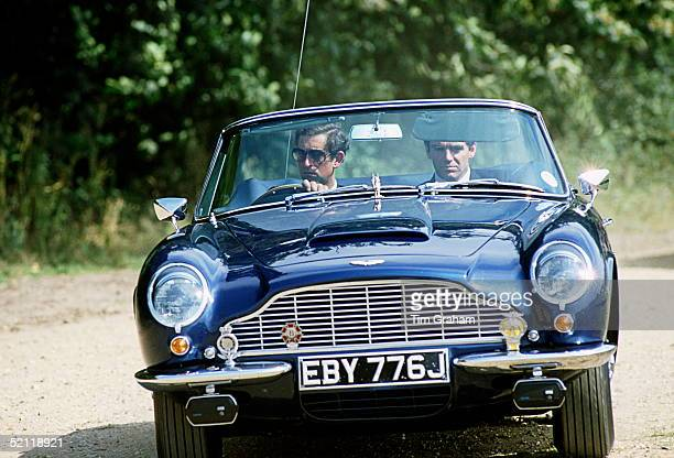 Prince Charles Driving His Aston Martin Db5 Volante Convertible Sports Car In Windsor With His Police Bodyguard Tony Parker Next To Him It Had Been A...
