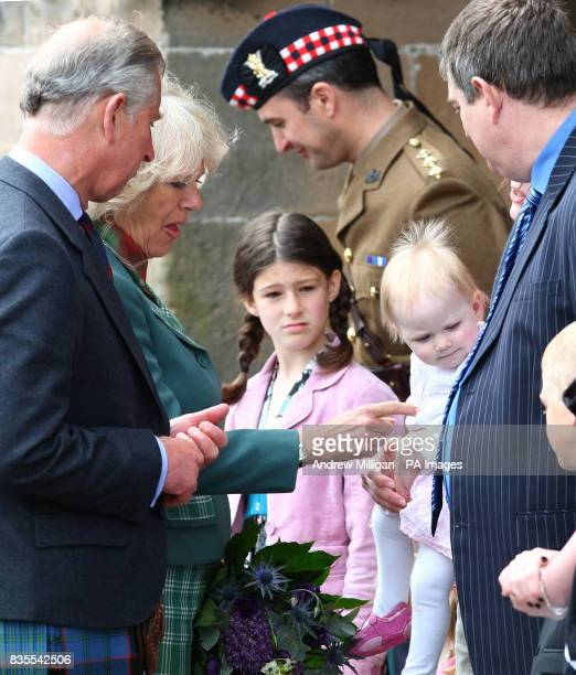 Prince Charles, Duke of Rothesay and Camilla Duchess of Cornwall, Duchess of Rothesay meet one year old Katie MacPherson, watched by mum Janette from...