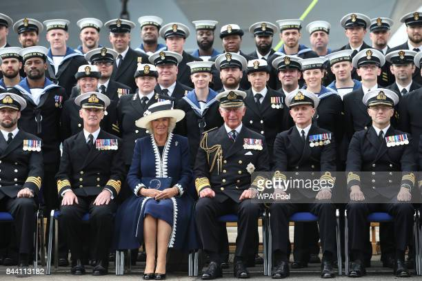 Prince Charles Duke of Rothesay and Camilla Duchess of Rothesay pose for a group photograph after a naming ceremony of aircraft carrier HMS Prince of...