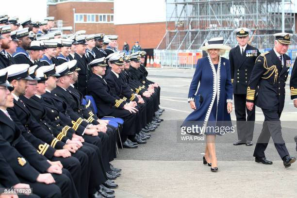 Prince Charles Duke of Rothesay and Camilla Duchess of Rothesay walk away having posed for a group photograph after a naming ceremony of aircraft...