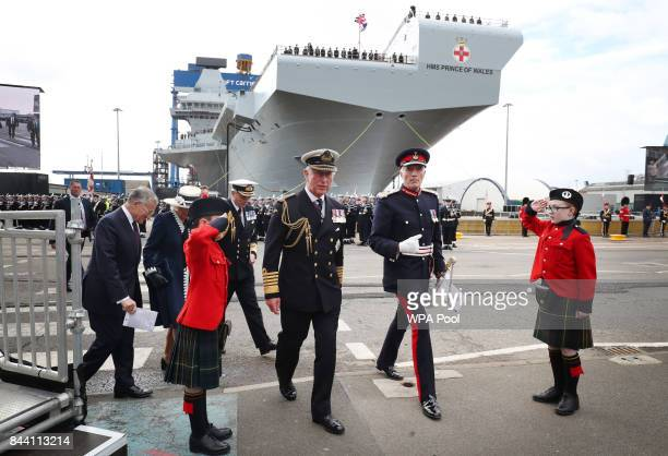 Prince Charles Duke of Rothesay and Camilla Duchess of Rothesaysay while in Scotland arrive for the naming ceremony of aircraft carrier HMS Prince of...