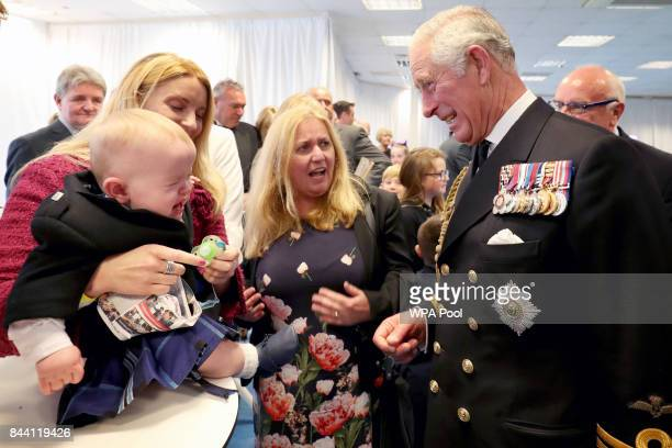 Prince Charles Duke of Rothesay meets 11 month old Myles Johnston at a reception following the naming ceremony for the HMS Prince of Wales aircraft...