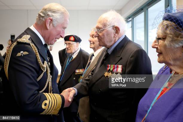 Prince Charles Duke of Rothesay meets veterans who served on the first HMS Prince of Wales during a naming ceremony of aircraft carrier HMS Prince of...