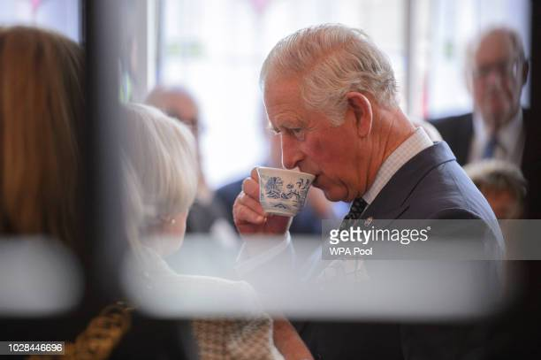 Prince Charles, Duke of Rothsay sips from a teacup during a visit to the Mackintosh at the Willow Tea Rooms on September 07, 2018 in London, United...