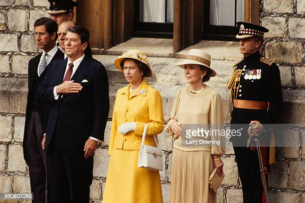 Prince Charles Duke Philip of Edinburgh and Queen Elizabeth II welcome US President Ronald Reagan and First Lady Nancy Reagan at Windsor Castle...