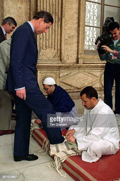 Prince Charles During His Official Tour Of Cairo Egypt The Prince Is Putting On A Pair Of Shoe Covers So That He May Enter The Sultan Hassan Mosque