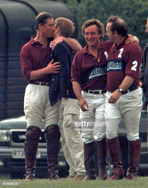 Prince Charles embraces his son Prince Harry at Hurtwood Polo Club Surrey 23rd May 1999 Rock drummer Kenney Jones is second right