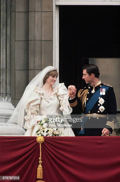 Prince Charles escorts Princess Diana to the balcony at Buckingham Palace just after their wedding