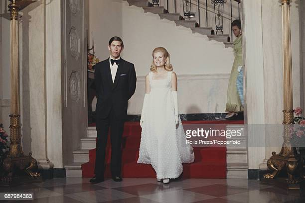 Prince Charles escorts Tricia Nixon daughter of President Richard Nixon to a formal White House dinner in Washington DC on 17th July 1970 Princess...