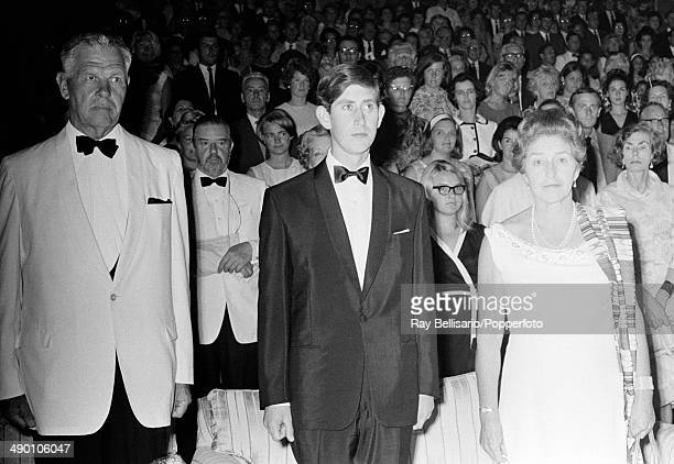 Prince Charles flanked by Sir Maurice Henry Dorman the GovernorGeneral of Malta and his wife Lady Dorman attending a performance of The Tempest in...