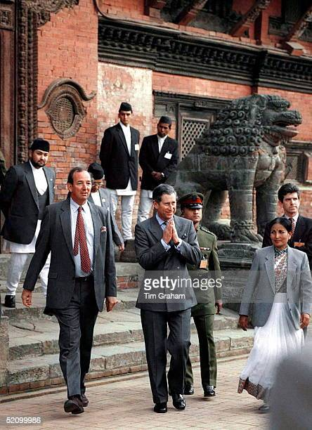 Prince Charles Followed By Prince Dipendra At Far Left In Front Of A Nepalese Temple In Patan