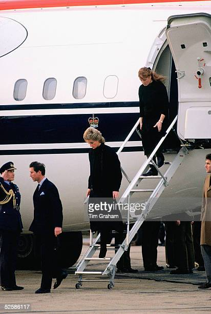 HRH Prince Charles followed by Princess Diana and the Duchess of York return to the UK with the coffin of their friend Major Hugh Lindsay who was...