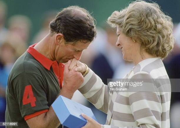 Prince Charles Gallantly Kissing The Hand Of Queen Annemarie Of Greece As She Presents Him With A Prize After Polo At Smiths Lawn Windsor