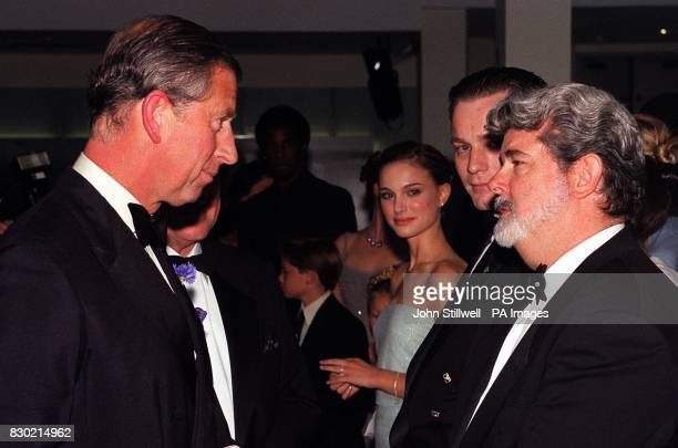 Prince Charles greets director George Lucas while stars Ewan McGregor and Natalie Portman look on at the Royal Premiere of Star Wars Episode 1 The...