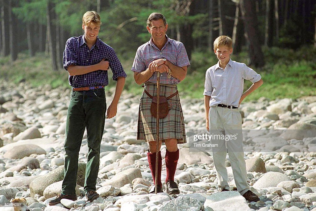 Prince Charles Holding A Walking Stick Styled As A Shepherd's Crook Stick With Prince William And Prince Harry At Polvier, By The River Dee, Balmoral Castle Estate