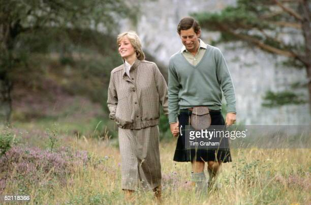 Prince Charles Holding Princess Diana's Hand During Their Honeymoon At Balmoral In Scotland.the Princess Is Wearing A Suit Designed By Bill Pashley...