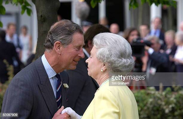 Prince Charles Holding The Hand Of His Mother Queen Elizabeth II As He Is Reaching Forward To Greet Her With A Kiss When They Met At The Chelsea...
