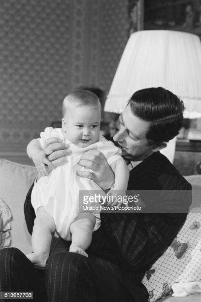 Prince Charles holds his baby son Prince William at Kensington Palace in London on 22nd December 1982