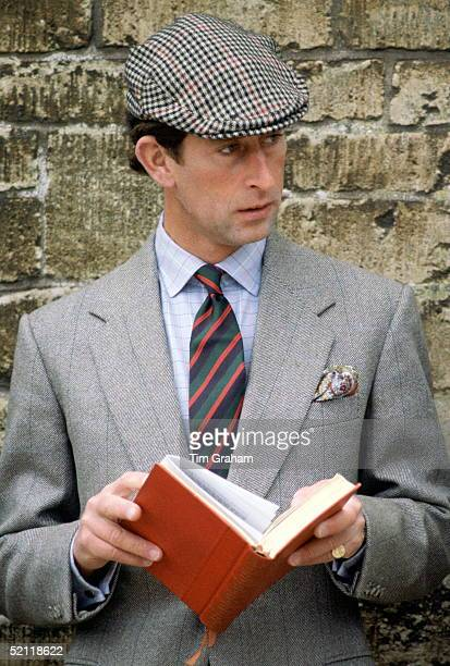 Prince Charles In Flat Cap And Country Suit Reading A Book At Badminton Horse Trials