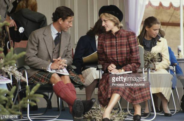 Prince Charles in highland dress and Princess Diana in a Caroline Charles suit at the Braemar Games Scotland September 1981