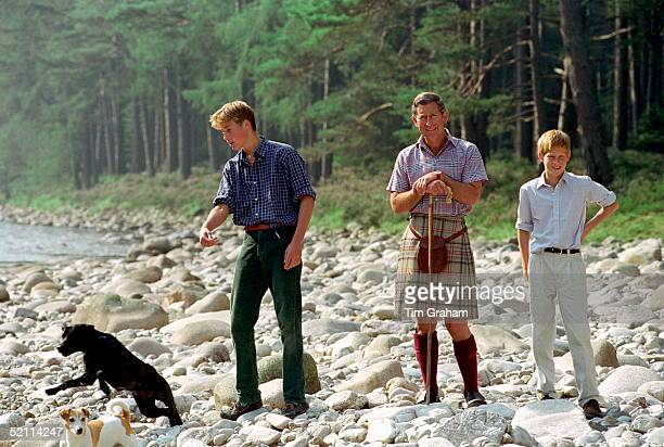 Prince Charles In Kilt And Sporran And Shepherd's Crook Walking Stick With Prince William Prince Harry At Polvier By The River Dee Balmoral Castle...