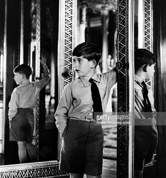 Prince Charles in one of the State Rooms at Buckingham Palace on his eighth birthday