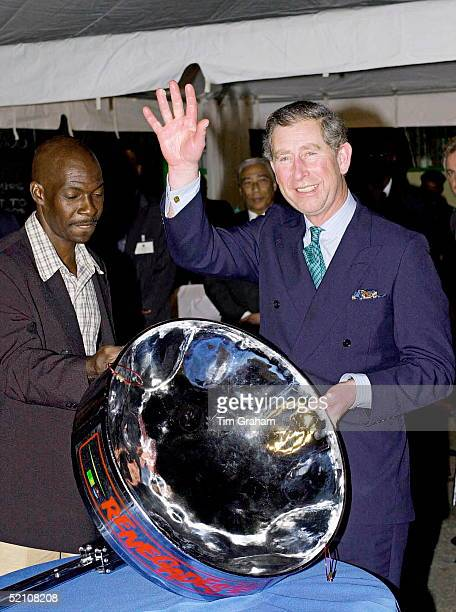 Prince Charles In Port Of Spain Trinidad With A Steel Drum Which Had Been Used At A Steel Band Concert At The Bp Amoco Pan Yard To Greet His Arrival