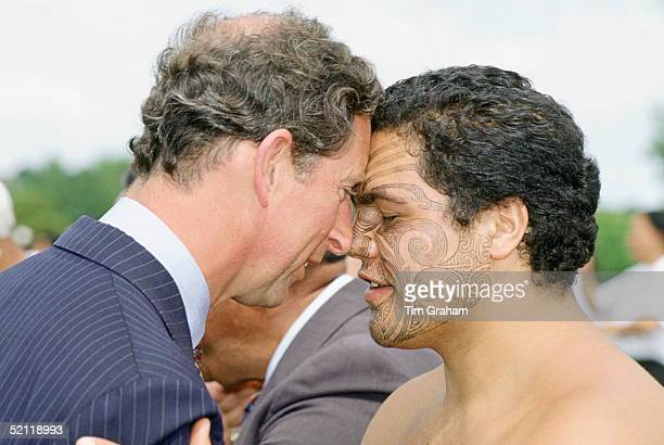Prince Charles Is Given The Traditional Hongi Nose Rubbing Welcome By A Maori Man With Painted Face During His Visit To New Zealand
