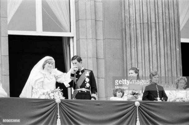 Prince Charles kissed the hand of his bride Lady Diana Spencer Picture taken of the happy couple on the balcony at Buckingham Palace after the...