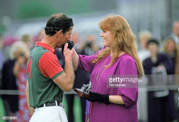 Prince Charles Kisses The Duchess Of York's Hand As She Presents Him With A Prize After A Polo Match At Windsor In Berkshire