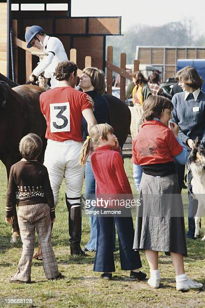 Prince Charles kissing Caroline Longman at a polo match circa 1979