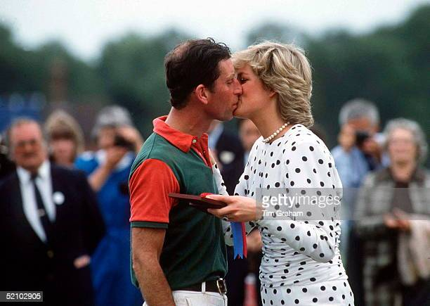 Prince Charles Kissing His Wife Princess Diana Who Is Presenting The Prizes After A Match At Guards Polo Club The Princess Is Wearing A White Dress...