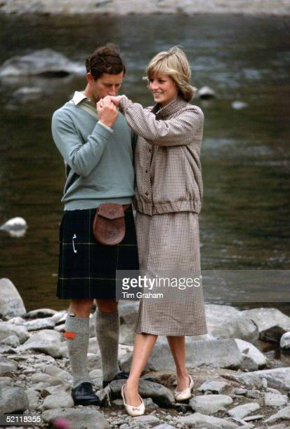 Prince Charles Kissing Princess Diana's Hand During Their Honeymoon At Balmoral In Scotland.the Princess Is Wearing A Suit Designed By Bill Pashley...