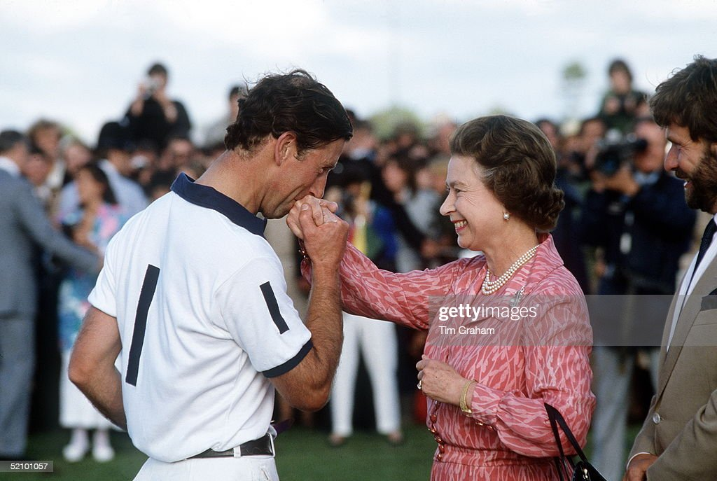 Prince Charles Kissing The Queen's Hand After She Presented Him With A Prize At Polo In Windsor