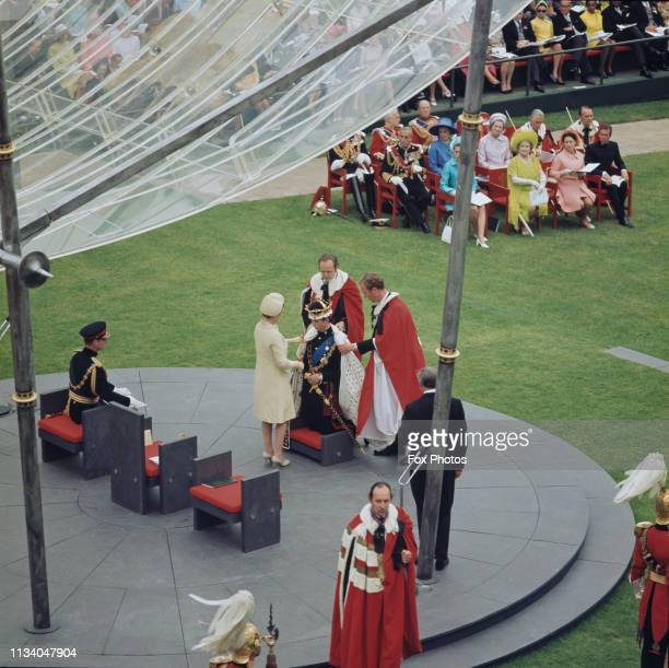 Prince Charles kneels before the Queen during the ceremony of his investiture as Prince of Wales at Caernarfon Castle, Gwynedd, Wales, 1st July...