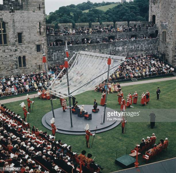 Prince Charles kneels before the Queen during the ceremony of his investiture as Prince of Wales at Caernarfon Castle, Gwynedd, Wales, 1st July 1969....
