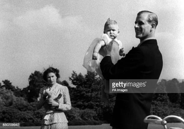 Prince Charles later The Prince of Wales is lifted up by his father The Duke of Edinburgh in the grounds of Windlesham Moor the country home in...