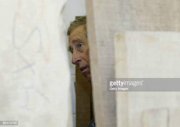 Prince Charles laughs during a visit to the MJ Cabinet makers studio March 24 2005 in Braithwaite Cumbria Prince Charles was visiting Cumbria today...