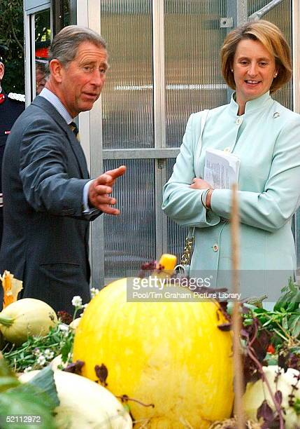 Prince Charles Looking At Produce With His Aide Assistant Private Secretary Elizabeth Buchanan During A Visit To Meanwood Valley Urban Farm As Patron...