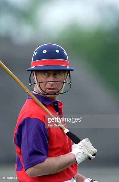 Prince Charles Looking Back Over His Shoulder As It Begins To Rain While He Is Playing On The highgrove Team For The Dorchester Polo Trophy To Raise...